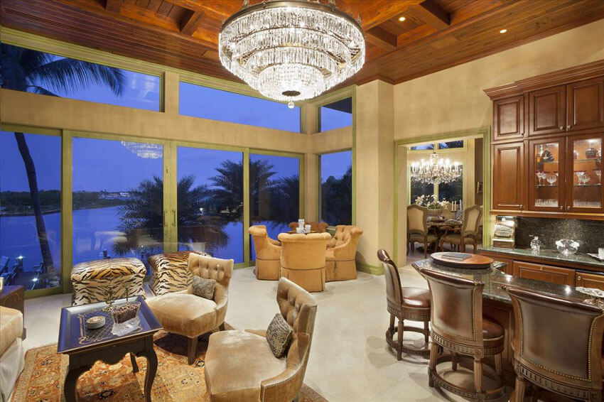 luxury-craftsman-living-room-with-view-of-canal-and-large-crystal-chandelier